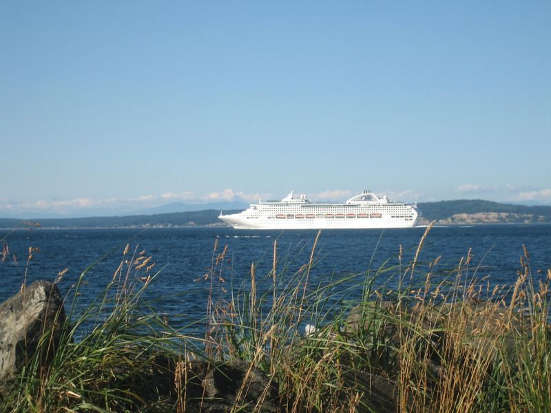 Cruise ship to Alaska goes by, Point No Point near lighthouse, Hansville, WA 2006