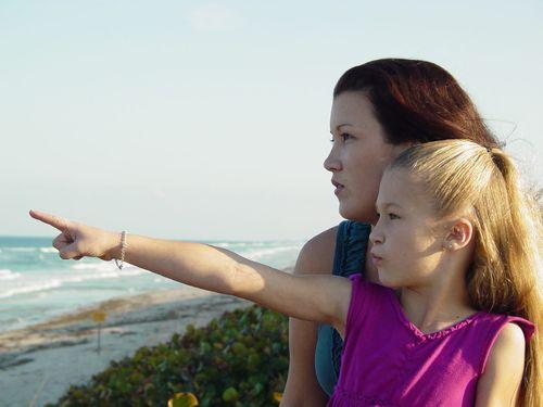 Ashley and  Brenna at Playalinda closeup with Brenna pointing