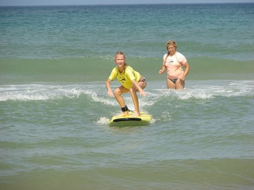 Brenna with surf instructor
